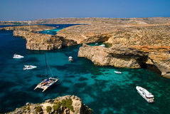 Comino full of yachts. Uninhabitted island of the Maltese archipelago between the islands of Malta and Gozo in the Mediterranean Sea royalty free stock images