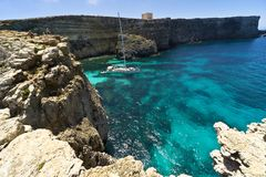 Malta, Comino island, panoramic view of the cliffs and the sea. Comino island, panoramic view of the cliffs and the sea Stock Image