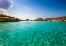 Comino, Malta - The beautiful azure sea water at the Blue Lagoon on the island of Comino. On a bright sunny summer day Royalty Free Stock Photo