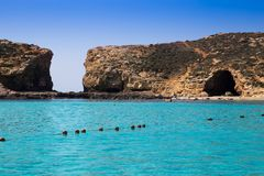 Comino, Malta - Beautiful azure sea water at the famous Blue Lagoon on the island of Comino. With clear blue sky on a sunny summer day Stock Image