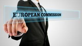 Comisión de Pointing Glowing European del hombre de negocios Foto de archivo