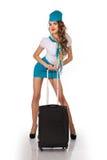 A comissária de bordo bonita guarda a bagagem imagem de stock royalty free