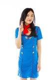 Comissária de bordo de ar asiática que cruza seus dedos Imagens de Stock Royalty Free