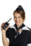 Comissária de bordo de sorriso bonita com rádio dos Cb Imagens de Stock Royalty Free