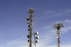 Comm Tower. Two communication towers shot against blue sky Stock Images