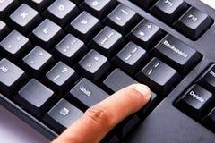 Command Key. Finger press the blanked enter key Stock Photo