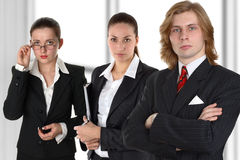 Command professional 2. Group from three young businessman before window Royalty Free Stock Photo