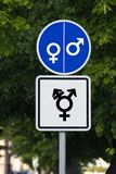 A command road sign with a female gender symbol on one half and a male gender symbol on the other half. The additional table has a. All welcome. Differences are stock images