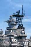 Command Tower and Weapons on US Navy Battleship. Command tower with radar and communication equipment above antiaircraft guns weapons on a US navy battleship Stock Image