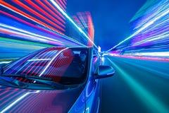 Commande de ville de nuit en la voiture Photographie stock