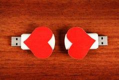 Commandes d'instantané d'USB avec des formes de coeur Photographie stock libre de droits