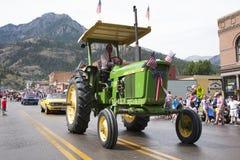 Commandes vertes de tracteur dans le défilé de Jour de la Déclaration d'Indépendance du 4 juillet Images libres de droits