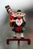 commandmdeg åtta figurines görar till kung apan Arkivbilder