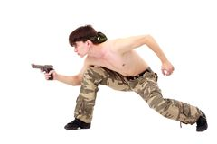 Commando. Man with gun on a white background Stock Images