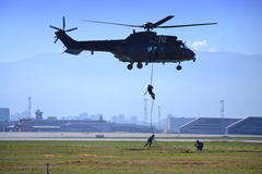 Commando descends on rope airport airshow Royalty Free Stock Images