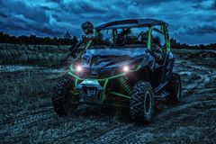 Army rangers moving on military buggy at night stock photography