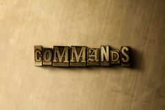 COMMANDS - close-up of grungy vintage typeset word on metal backdrop Royalty Free Stock Images