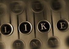 COMME le mot sur la machine à écrire de vintage Photographie stock