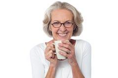 Comme pour me joindre pour une tasse de café ? Photo stock
