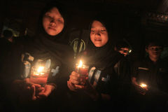 Commemorate Earth Hour. Residents lit candles during the celebration of Earth Hour in Solo, Central Java, Indonesia. Movement switch off electricity for 60 Stock Images