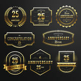 Commemorate golden labels design. Collection of commemorate golden labels design set over black background Royalty Free Stock Photo