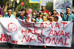 Commemorate the national child. Some of students with residents held a demonstration to commemorate the national child in Solo, Central Java, Jawa Tengah Royalty Free Stock Image