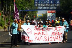 Commemorate the national child. Some of students with residents held a demonstration to commemorate the national child in Solo, Central Java, Jawa Tengah Stock Image
