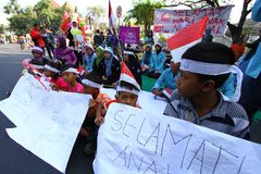 Commemorate the national child. Some of students with residents held a demonstration to commemorate the national child in Solo, Central Java, Jawa Tengah Royalty Free Stock Images