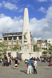 Commemoration monument on Dam Square, Amsterdam, Netherlands. AMSTERDAM-JULY 18, 2009. Dam monument on July 18, 2009. The white stone pillar is a National stock photos