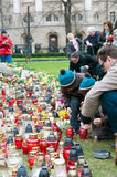 Commemoration of tragedy. Family lighten candles at Monument of Katyn Victims to commemorate plane crash. Begin of week of mourning in Poznan, Poland Stock Photos
