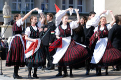 Commemoration of the uprising. KAPOSVAR, HUNGARY - MARCH 15: Folk dancers dancing at commemoration of 159nd anniversary of the Hungarian Revolution on 15th of Stock Photography