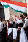 Commemoration of the uprising. KAPOSVAR, HUNGARY - MARCH 15: Folk dancer waves the flag at commemoration of 159nd anniversary of the Hungarian Revolution on 15th Stock Photo