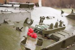 Commemorative flowers lie on the tank. Stock Images