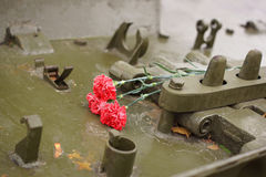 Commemorative flowers lie on the tank. Stock Photography