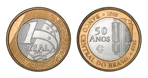 Commemorative `One Real` brazilian coin Central Bank `fifty years 1965`. Isolated on white background with clipping path Royalty Free Stock Photo