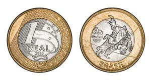 Commemorative `One Real` brazilian coin - Olympics games Rio 2016. With clipping path Royalty Free Stock Photography