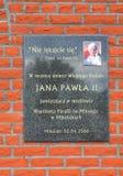 Commemorative plaque of John Paul II. MIKOLAJKI, POLAND — MAY 10, 2014: Commemorative plaque of John Paul II on the wall of the Roman Catholic parish of St Stock Photos