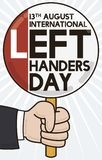 Commemorative Sign to Celebrate Left Handers Day, Vector Illustration. Executive suit sleeve and left hand holding a commemorative sign to celebrate vector illustration