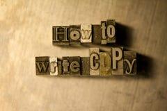 Comment écrire la copie - Metal le signe de lettrage d'impression typographique Photo stock