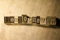 Comment passer en revue - Metal le signe de lettrage d'impression typographique Images stock