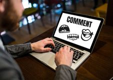 Comment text and cartoon mouth graphic on laptop screen with mans hands. Digital composite of Comment text and cartoon mouth graphic on laptop screen with mans Royalty Free Stock Photos