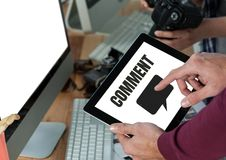 Comment text and chat graphic on tablet screen with hands Stock Photo