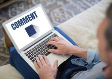 Comment text and graphic on laptop screen with hands Royalty Free Stock Photo