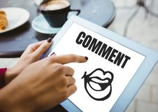 Comment text and mouth graphic on tablet screen with hands Royalty Free Stock Photo