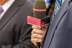 Commentatore della televisione Immagini Stock
