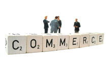 Commerce and business. A couple of businessmen and the word commerce royalty free stock images