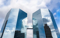 The Commerce Place buildings in Hamilton, Ontario, Canada. Two octagonal Skyscrapers reflecting clouds and sky in the glass fronts. The Commerce Place buildings Stock Photos