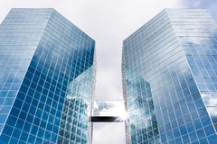 The Commerce Place buildings in Hamilton, Ontario, Canada. Two octagonal Skyscrapers reflecting clouds and sky in the glass fronts. The Commerce Place buildings Stock Photo
