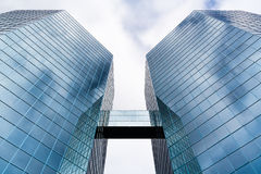 The Commerce Place buildings in Hamilton, Ontario, Canada. Two Skyscrapers linked by an overground connection reflecting clouds and sky in the glass fronts. The Royalty Free Stock Photo