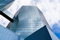 The Commerce Place buildings in Hamilton, Ontario, Canada. Two Skyscrapers linked by an overground connection reflecting clouds and sky in the glass fronts. The Stock Photo